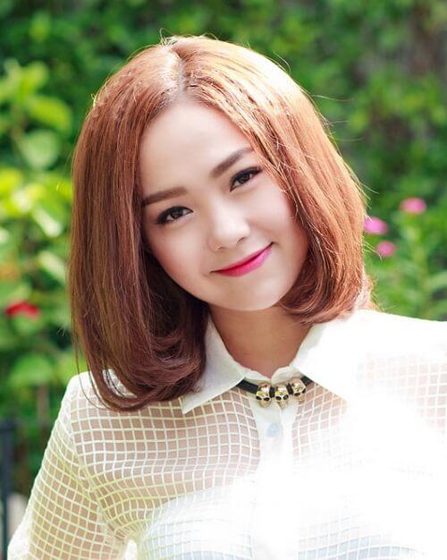 Ca sĩ Minh Hằng trẻ trung hơn với mái tóc uốn ngắn