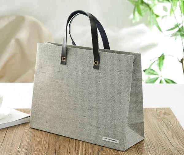 Túi giấy quai bằng da